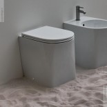 Axa Stand-WC DP | spülrandlos | 50cm | mit WC-Sitz weiß